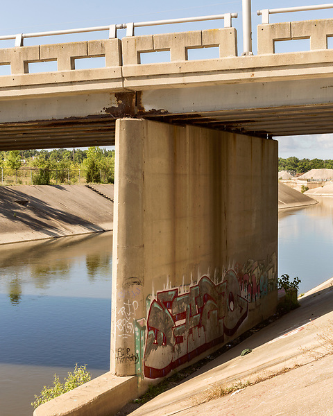 August 6, 2016. Flint, Michigan.<br />  The Stevenson Street Bridge over try Flint River. <br />  In April 2014, the city of Flint switched its water source from the Detroit Water and Sewerage Department to using the Flint River in an effort to save money. When the switch occurred, the city failed to have corrosion control treatment in place for the new water. This brought about a leaching of lead from pipes into the water, increasing the lead content in the drinking water to levels far above legal limits. After independent sources brought this to light, the city admitted the water was unsafe and legal battles have ensued between resident and the local and state governments.