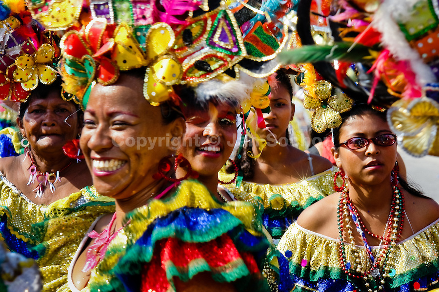 Colombian women, wearing a colorful costumes, dances during the Carnival in Barranquilla, Colombia, 27 February 2006. The Carnival of Barranquilla is a unique festivity which takes place every year during February or March on the Caribbean coast of Colombia. A colourful mixture of the ancient African tribal dances and the Spanish music influence - cumbia, porro, mapale, puya, congo among others - hit for five days nearly all central streets of Barranquilla. Those traditions kept for centuries by Black African slaves have had the great impact on Colombian culture and Colombian society. In November 2003 the Carnival of Barranquilla was proclaimed as the Masterpiece of the Oral and Intangible Heritage of Humanity by UNESCO.