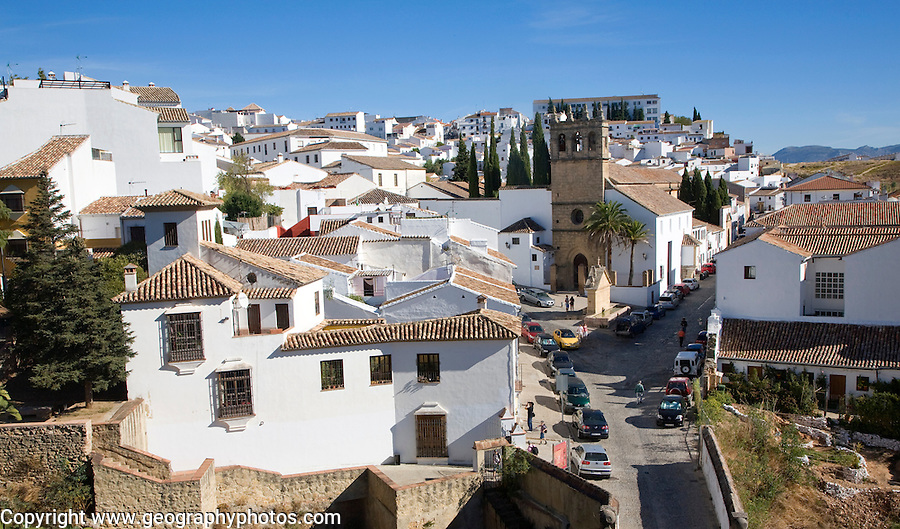 Church Iglesia de Nuestro Padrre Jesus and white buildings in the new city of Ronda, Spain
