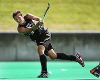 NZ's Simon Child passes during the international hockey match between the New Zealand Black Sticks and India at National Hockey Stadium, Wellington, New Zealand on Saturday, 20 February 2009. Photo: Dave Lintott / lintottphoto.co.nz