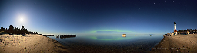 Northern Lights aurora borealis, moon, and Crisp Point Lighthouse over Lake Superior, 180 degree panorama. Epson International Pano Bronze Award Winner, 2012