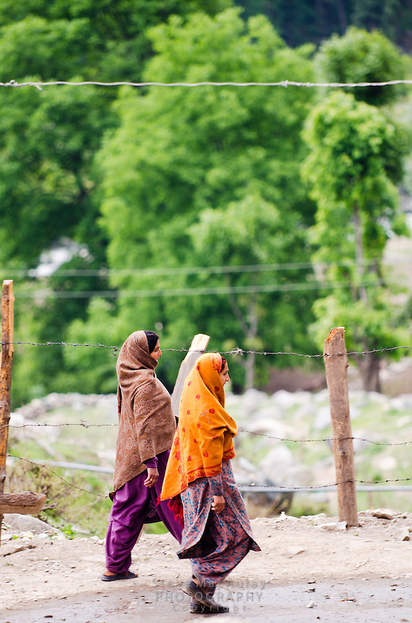 Two gypsy women in colorful clothing, Naranag, Kashmir, India.