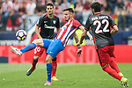 Saul Niguez Esclapez (C) of Atletico de Madrid fights for the ball with Raul Garcia (R) of Athletic Club during their La Liga match between Atletico de Madrid vs Athletic de Bilbao at the Estadio Vicente Calderon on 21 May 2017 in Madrid, Spain. Photo by Diego Gonzalez Souto / Power Sport Images