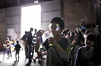 Pictured: A young boy blows bubbles in a disused warehouse where migrants have taken shelter Monday 07 March 2016<br /> Re: Migrants have been gathering at the port of Piraeus, near Athens, Greece.