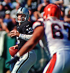 Oakland Raiders vs. Cincinnati Bengals at Oakland Alameda County Coliseum Sunday, October 25, 1998.  Raiders beat Bengals 27-10.  Oakland Raiders quarterback Donald Hollas (12).