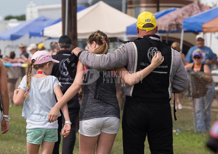 Apr. 28, 2013; Baytown, TX, USA: NHRA top fuel dragster driver Bob Vandergriff Jr celebrates with his daughters after winning the Spring Nationals at Royal Purple Raceway. Mandatory Credit: Mark J. Rebilas-