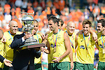 The Hague, Netherlands, June 15: The FIH president Leandro Negro hands over the World Cup Trophy to Mark Knowles #9 of Australia after the Kookaburras have beaten the team of The Netherlands 6-1 (2-1) in the final of the World Cup on June 15, 2014 during the World Cup 2014 at Kyocera Stadium in The Hague, Netherlands. (Photo by Dirk Markgraf / www.265-images.com) *** Local caption ***
