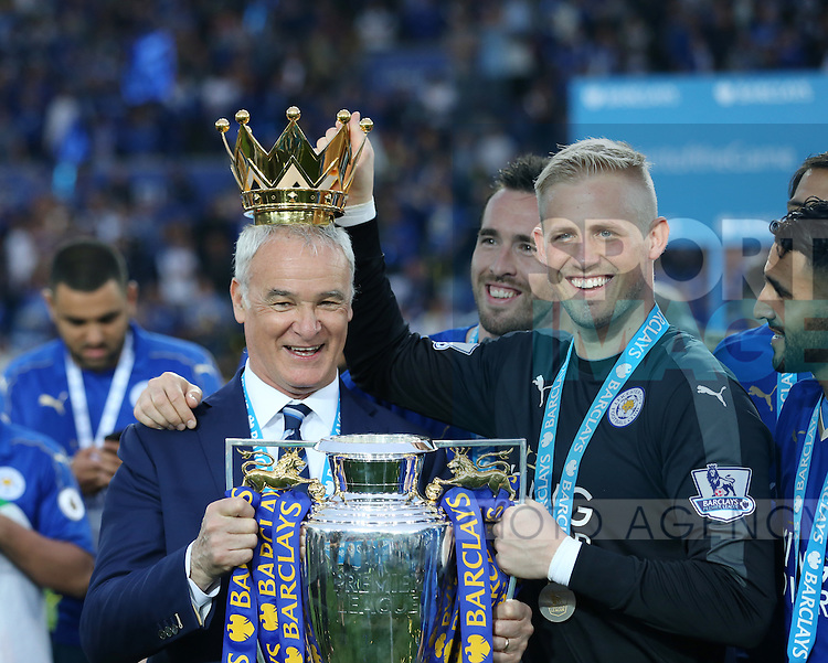 Leicester's Claudio Ranieri and Kasper Schmeichel celebrate with the trophy during the Barclays Premier League match at the King Power Stadium.  Photo credit should read: David Klein/Sportimage