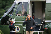 United States President Barack Obama salutes the Marine Guard as he steps off Marine One after arriving on the South Lawn of the White House on August 26, 2012 in Washington, DC. Obama was returning from a weekend stay at Camp David. .Credit: Pete Marovich / Pool via CNP