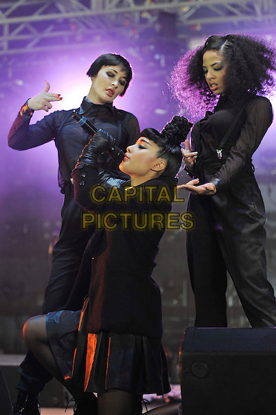 Natalia Kills (Natalia Noemi Cappuccini) .Performs on during Day One of Wireless Festival, Hyde Park, London, England, UK, 1st July 2011..half length music live on stage concert gig top knot hair up bun black gloves jacket  leather skirt  white shirt microphone singing .CAP/MAR.© Martin Harris/Capital Pictures.