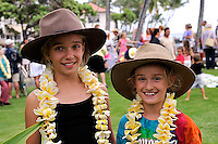 Two sisters (11 years old, 8 years old) wearing Akubra hats and freshly made frangipani leis. Kailua-Kona, Big Island, Hawaii RIGHTS MANAGED LICENSE AVAILABLE FROM www.PhotoLibrary.com