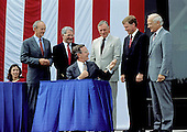 United States President George H.W. Bush signs a proclamation after announcing plans for the Space Exploration Initiative (SEI) on the the 20th anniversary of the Apollo 11 Moon landing at the National Air and Space Museum in Washington, D.C. on July 20, 1989.  From left to right: Marilyn Quayle (seated); Apollo 11 Command Module pilot Michael Collins; NASA Administrator Richard H. Truly; President Bush; Apollo 11 Command pilot Neil A. Armstrong; U.S. Vice President Dan Quayle; and Apollo 11 Lunar Module pilot Edwin (Buzz) Aldrin.<br /> Credit: Robert Trippett / Pool via CNP