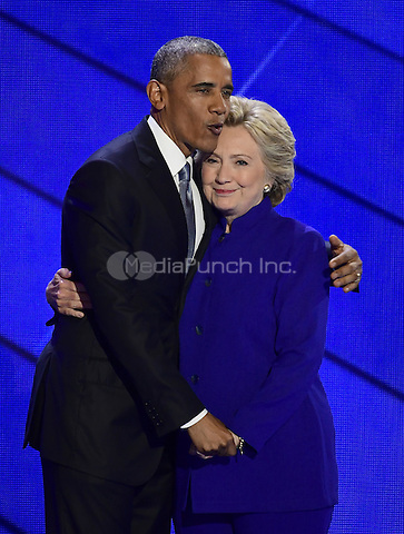 United States President Barack Obama and former US Secretary of State Hillary Clinton after he completed his remarks during the third session of the 2016 Democratic National Convention at the Wells Fargo Center in Philadelphia, Pennsylvania on Wednesday, July 27, 2016.<br /> Credit: Ron Sachs / CNP/MediaPunch<br /> (RESTRICTION: NO New York or New Jersey Newspapers or newspapers within a 75 mile radius of New York City)
