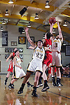 Palos Verdes, CA January 19, 2010 - Stephanie Wong (3) tries to grab a rebound as Palos Verdes' Kelsey Brockway (23) tries to tip it away from her while Neha Savant (22) leans on Brockway during the Palos Verdes vs Peninsula Panthers basketball game at Peninsula High School.