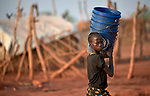 A girl carries buckets in the Yida refugee camp in South Sudan. Some 53,000 refugees from Sudan's Nuba Mountains live in the camp, with an equal number living in two nearby camps.