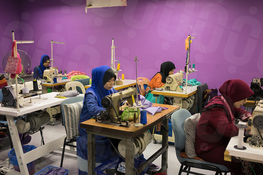 January 10, 2015 - Rawang (Malaysia). Young members of the organisation produce clothes to sell in the company's shops. The enterprise, which employs 4,000 people worldwide through its complicated network of subsidiaries, operates restaurants, clothing shops, noodle factories and health clinics - just to name a few. It also runs its own schools, care homes and rehabilitation centres. © Thomas Cristofoletti / Ruom