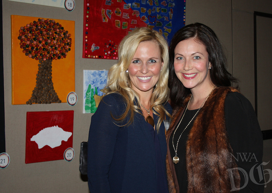 NWA Democrat-Gazette/CARIN SCHOPPMEYER Courtney Barton (left) and Sara Davis attend the Fayetteville Montessori School art auction.