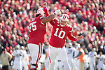Wisconsin Badgers teammates Micah Kapoi (75) and kicker Rafael Gaglianone (10) celebrate a field goal during an NCAA Big Ten Conference college football game against the Purdue Boilermakers Saturday, October 17, 2015, in Madison, Wis. The Badgers won 24-7. (Photo by David Stluka)