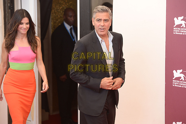 Sandra Bullock, George Clooney<br /> The 'Gravity' photocall during the 70th Venice International Film Festival at the Palazzo del Casino, Venice, Italy.<br /> August 28th, 2013<br /> half length black suit stripe white shirt blue orange pink green dress<br /> CAP/ZZG<br /> &copy;ZZG/Capital Pictures