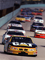Ward Burton leads a line of cars down the frontstretch during the Pennzoil 400 at Homestead-Miami Speedway in November 2000. (Photo by Brian Cleary)