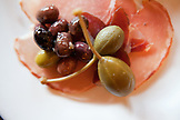 USA, California, Sonoma, The Girl and the Fig restaurant, cured meat, capers and olives