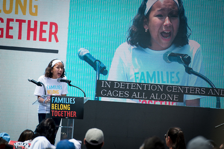 UNITED STATES – June 30: A young girl speaks about her family's struggles as immigrants at the Families Belong Together protest outside of the White House Saturday June 30, 2018.  (Photo By Sarah Silbiger/CQ Roll Call)
