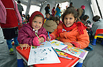 "Two girls from Afghanistan color inside a ""child-friendly space"" in a refugee processing center in the Serbian village of Presevo, not far from the Macedonian border. Hundreds of thousands of refugees and migrants--including many children--have flowed through Serbia in 2015, on their way from Syria, Iraq and other countries to western Europe."
