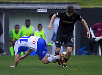 Lautoka's Cory Chettleburgh tackles Team Wellington's Andy Bevin during the Oceania Football Championship final (first leg) football match between Team Wellington and Lautoka FC at David Farrington Park in Wellington, New Zealand on Sunday, 13 May 2018. Photo: Dave Lintott / lintottphoto.co.nz