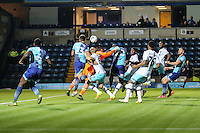 Adebayo Akinfenwa of Wycombe Wanderers (20 - centre) scores the opening goal of the game during the The Checkatrade Trophy match between Wycombe Wanderers and West Ham United U21 at Adams Park, High Wycombe, England on 4 October 2016. Photo by David Horn.