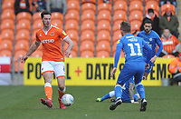 Blackpool's Ben Heneghan under pressure from Peterborough United's Louis Reed<br /> <br /> Photographer Kevin Barnes/CameraSport<br /> <br /> The EFL Sky Bet League One - Blackpool v Peterborough United - Saturday 13th April 2019 - Bloomfield Road - Blackpool<br /> <br /> World Copyright &copy; 2019 CameraSport. All rights reserved. 43 Linden Ave. Countesthorpe. Leicester. England. LE8 5PG - Tel: +44 (0) 116 277 4147 - admin@camerasport.com - www.camerasport.com