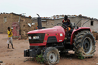 "ANGOLA Malanje, ""election tractor"" in many villages new tractors were given to chiefs by the party in power MPLA as gift before election, after unexperienced use the tractors are out of order and there is now money for spare parts or maintainance  / ANGOLA Malanje , ""election tractor"" in vielen Doerfern verrotten neue Traktoren ungenutzt, sie wurden als Wahlkampfgeschenke von der Regierungspartei MPLA an Dorf chiefs verteilt"