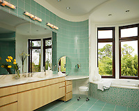 Her master bath with water colored glass tiles