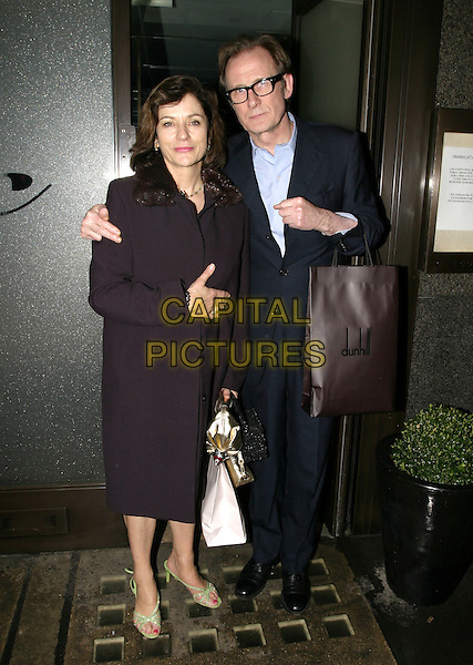 BILL NIGHY & GUEST.Pre-BAFTA Party, hosted by Vogue Magazine,  Cecconi, London, February 10th 2005..full length .Ref: AH.www.capitalpictures.com.sales@capitalpictures.com.©Capital Pictures.
