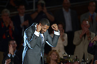 Canton, Ohio - August 1, 2014: Former Defensive End Michael Strahan reacts to applause from the audience as he is introduced before accepting his gold jacket during the Pro Football Hall of Fame's class of 2014 enshrinement dinner in Canton, Ohio  August 1, 2014. Strahan had 22.5 sacks in a single season (2001) and lead the NFL in sacks in 2001 and 2003.  (Photo by Don Baxter/Media Images International)