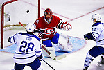 10 April 2010: Montreal Canadiens' goaltender Jaroslav Halak makes a second period save against the Toronto Maple Leafs at the Bell Centre in Montreal, Quebec, Canada. The Maple Leafs defeated the Canadiens 4-3 in sudden death overtime. Mandatory Credit: Ed Wolfstein Photo
