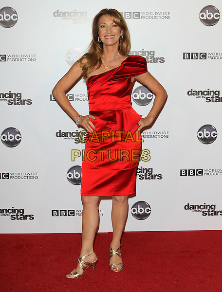 JANE SEYMOUR.'Dancing With The Stars' 200th Episode held at Boulevard 3, Hollywood, CA, USA..November 1st, 2010.full length red silk satin dress one shoulder hands on hips gold sandals .CAP/ADM/FS.©Faye Sadou/AdMedia/Capital Pictures.