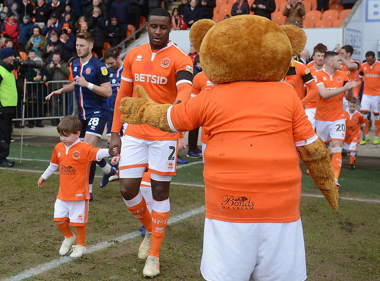Blackpool's Donervon Daniels walks out with a mascot<br /> <br /> Photographer Kevin Barnes/CameraSport<br /> <br /> The EFL Sky Bet League One - Blackpool v Walsall - Saturday 9th February 2019 - Bloomfield Road - Blackpool<br /> <br /> World Copyright © 2019 CameraSport. All rights reserved. 43 Linden Ave. Countesthorpe. Leicester. England. LE8 5PG - Tel: +44 (0) 116 277 4147 - admin@camerasport.com - www.camerasport.com