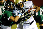 Torrance, CA 10/06/11 - Justin Concetti (South Torrance #7) and James Nelson (Peninsula #26) in action during the Peninsula vs South Varsity football game.