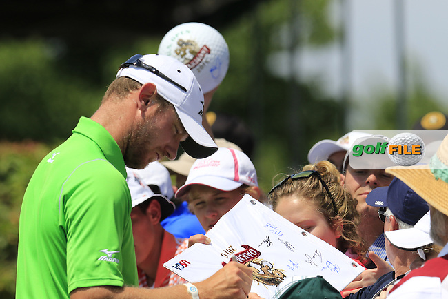 Chris Wood (ENG) signs autographs for fans during Wednesday's Practice Day of the 2016 U.S. Open Championship held at Oakmont Country Club, Oakmont, Pittsburgh, Pennsylvania, United States of America. 15th June 2016.<br /> Picture: Eoin Clarke | Golffile<br /> <br /> <br /> All photos usage must carry mandatory copyright credit (&copy; Golffile | Eoin Clarke)