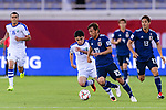 Javokhir Sidikov of Uzbekistan (L) fights for the ball with Takashi Inui of Japan (R) during the AFC Asian Cup UAE 2019 Group F match between Japan (JPN) and Uzbekistan (UZB) at Khalifa Bin Zayed Stadium on 17 January 2019 in Al Ain, United Arab Emirates. Photo by Marcio Rodrigo Machado / Power Sport Images