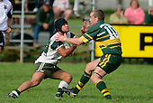 Manurewa halfback J. Davies has to contend with Pukekohe first five F. Hodgeson. Counties Manukau Premier Club Rugby, Pukekohe v Manurewa  played at the Colin Lawrie field, on the 17th of April 2006. Manurewa won 20 - 18.