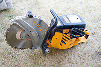 Rugged firefighters circular hand saw at rescue demonstration. Aquatennial Beach Bash Minneapolis Minnesota USA