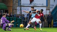 Sam Wood of Wycombe Wanderers holds off Lewis Young of Crawley Town to hit a shot at goal during the Sky Bet League 2 match between Wycombe Wanderers and Crawley Town at Adams Park, High Wycombe, England on 28 December 2015. Photo by Andy Rowland / PRiME Media Images