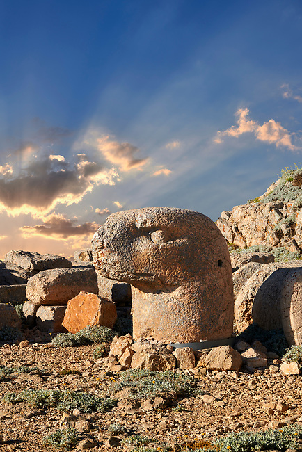 Statue head at sunrise of an Eagle in front of the stone pyramid 62 BC Royal Tomb of King Antiochus I Theos of Commagene, east Terrace, Mount Nemrut or Nemrud Dagi summit, near Adıyaman, Turkey