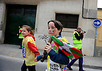 "People run in Tutera on March 26, 2015, Basque Country. The ""19th Korrika"" is a relay of hand to hand baton passing without interruption over 11 days and 10 nights crossing many Basque villages and cities, totalling some 2300 kilometres in a bid to promote the basque language.The ""Korrika"" this year end in Bilbao on March 29. (Ander Gillenea / Bostok Photo)"