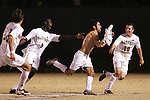 8 December 2007: Wake Forest's Austin da Luz (shirtless, center) races to celebrate with the home fans after scoring his game winning overtime goal, as teammates Marcus Tracy (9) and Corben Bone (10) race to congratulate him. Wake Forest University defeated Notre Dame University 1-0 in overtime at Spry Stadium in Winston-Salem, NC in an NCAA Men's Soccer tournament quarterfinal.