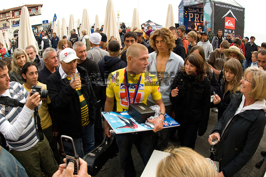 Australian Mick Fanning with his prizes after the Quiksilver Pro in France.