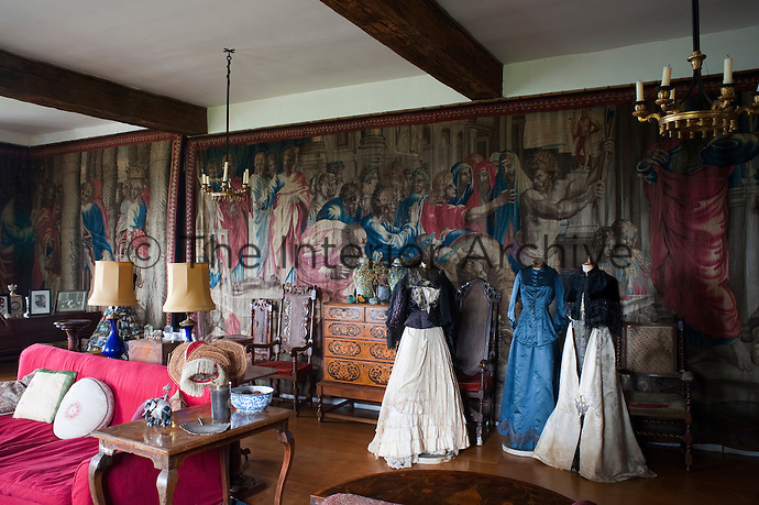 The Long Room at Hilles with Mortlake tapestries of The Acts of the Apostles and mannequins wearing costumes collected by Detmar Blow's mother
