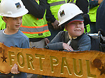 Paul Gramuglia, 6,  with construction workers  and s his brother and his best friend Leo, 9, with the sign for his Fort Paul, a large playscape in his backyard, as his brother and his best friend Leo, 9, looks on,  as a wish comes true for the 6-year-old who is confined to a wheel chair courtesy of Make-A-Wish,  Friday, Oct. 25, 20107,   their South Windsor home. (Jim Michaud / Journal Inquirer)