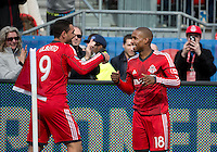 Toronto, Ontario - May 17, 2014: Toronto FC forward Jermain Defoe #18 celebrates his goal with Toronto FC forward Gilberto #9 during the 1st half in  a game between the New York Red Bulls and Toronto FC at BMO Field.